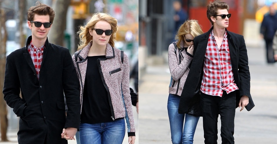 O casal Emma Stone e Andrew Garfield anda de m&#227;os dadas no bairro de Chelsea, em Nova York. Ao ver o fot&#243;grafo, Emma tenta se esconder. Os dois fazem par rom&#226;ntico em &#34;O Espetacular Homem-Aranha&#34;, que estreia em junho (30/3/12)