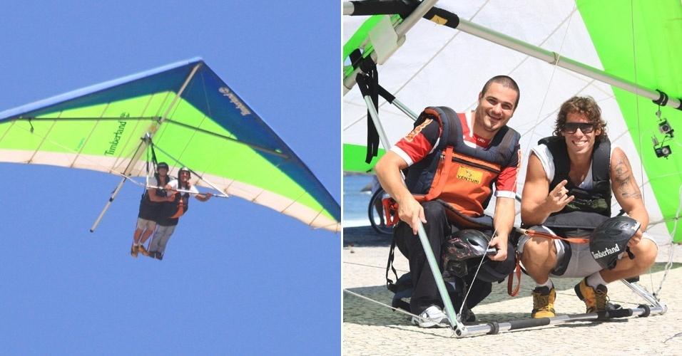 Os ex-BBB Rafa e Maurício voam de asa delta na praia de São Conrado, no Rio de Janeiro (14/4/12)