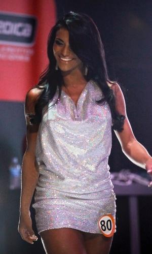 A vencedora Marissol em seu desfile de roupa