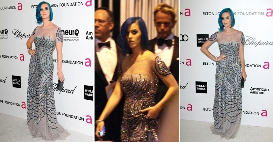 Para os looks de noite, Katy Perry costuma investir em vestidos românticos, geralmente com bastante bordado, em cores claras e delicadas. Para ir à festa Elton John AIDS Foundation, a cantora usou um longo Blumarine acinzentado, com bordado colorido e colo transparente (27/02/2012)