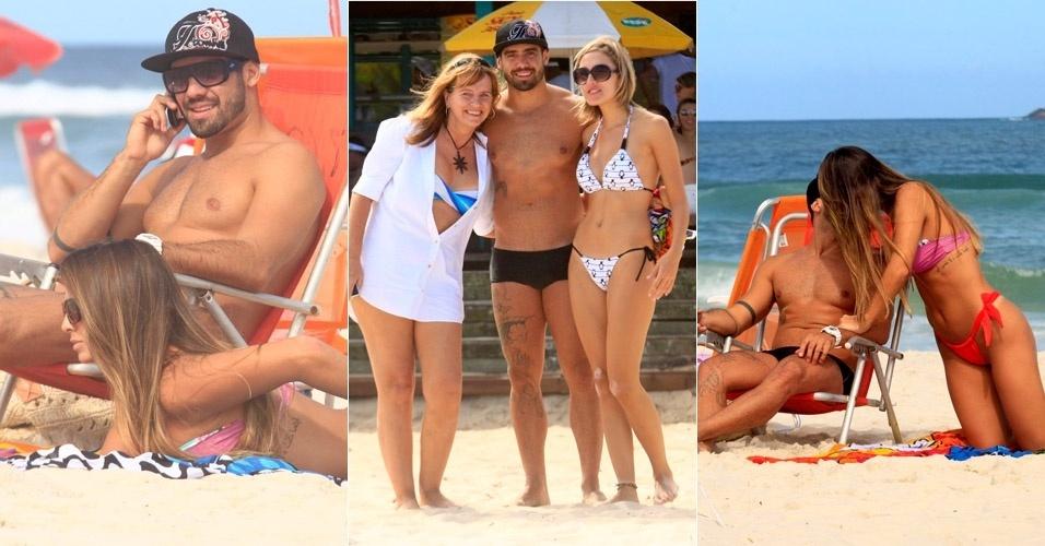 O ex-BBB Yuri curte praia com nova namorada e tira fotos com as fãs no Rio de Janeiro (6/5/12)