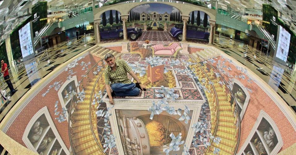 11.mai.2012 - O artista norte-americano Stefan Wermuth divulga sua instalação de arte em 3D em terminal do Aeroporto Internacional Changi, em Cingapura