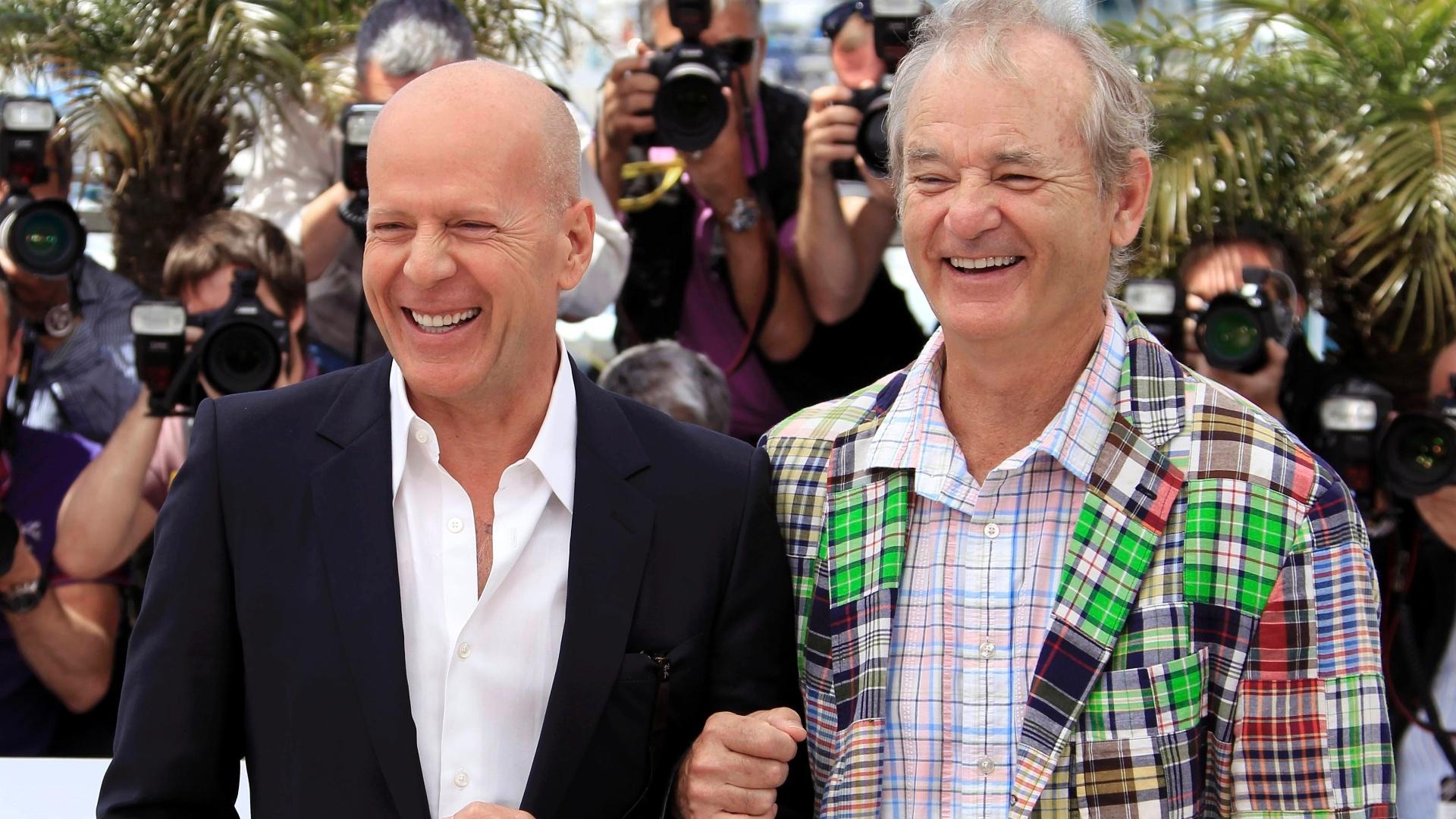 Os atores Bruce Willis (esq.) e Bill Murray (dir.) durante fotos para divulgação do filme