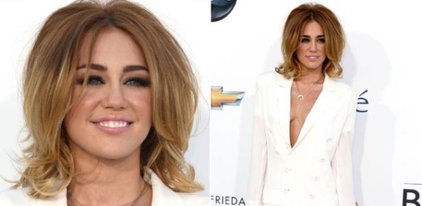 Miley Cyrus exibe novo visual e usa vestido decotado em premiação (20/5/12)