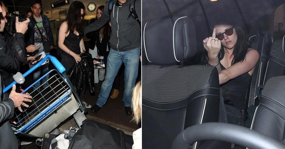 A caminho do Festival de Cannes, a atriz Kristen Stewart perde a paciência no aeroporto de Nice, na França, deixa as malas cairem do carrinho e, dentro de um carro, mostra o dedo médio para os fotógrafos (23/5/12)