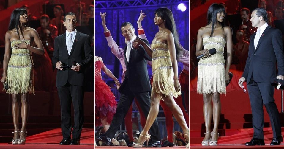 Naomi Campbell e o ator espanhol Antonio Banderas participaram de um evento beneficente em Viena, Áustria, e a modelo passou por alguns apuros com seu vestido, que insistiu em cair (19/5/12)