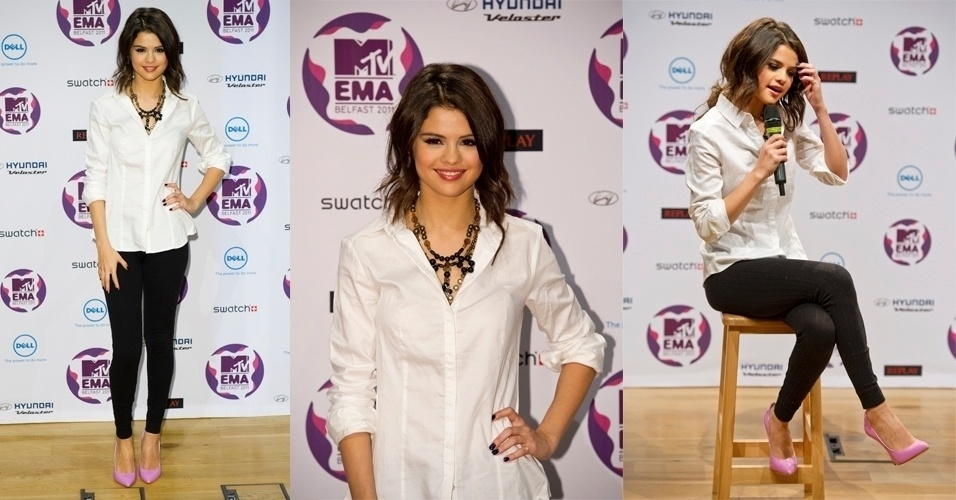 Calças skinny (bem justinhas no corpo) e blusas soltinhas formam o conjunto favorito de Selena Gomez em seus looks casuais. Para ir ao MTV Europe Music Awards, ela optou por peças básicas, como a calça preta e a camisa branca, com assessórios chamativos, como o scarpin rosa e o maxi colar (05/11/2011)