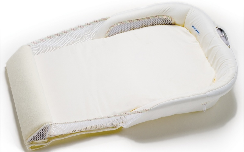 Berço portátil, da marca The First Years