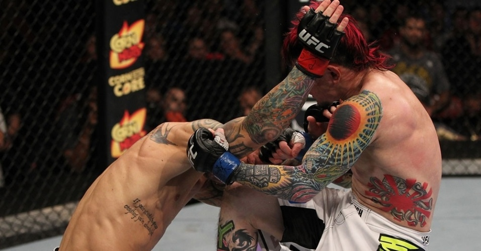 Tatuados Scott Jorgensen (d) e Eddie Wineland se enfrentam no UFC on FX 3, nos EUA