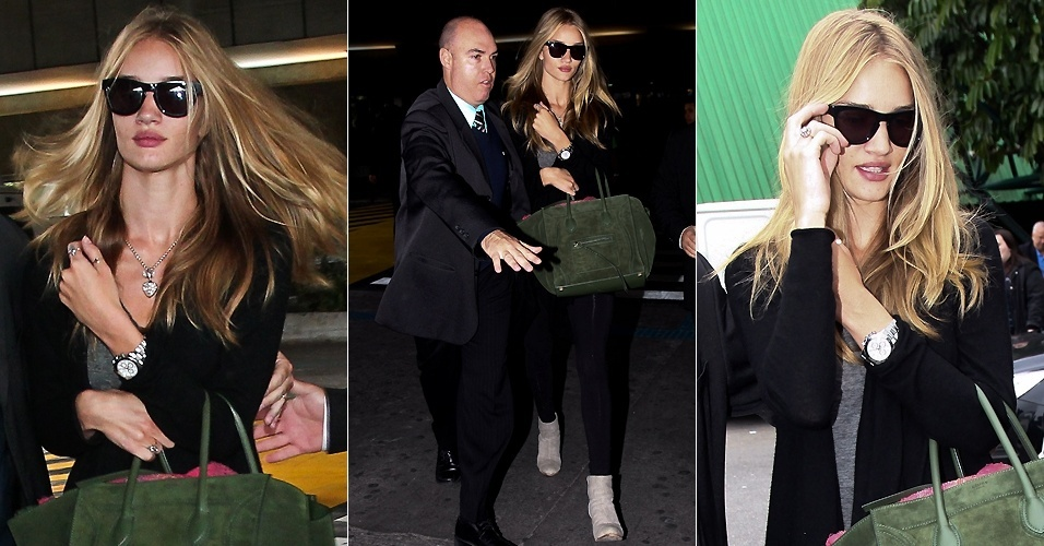 Cercada por seguranças, a atriz Rosie Huntington-Whiteley desembarca no aeroporto de Guarulhos (10/6/12)