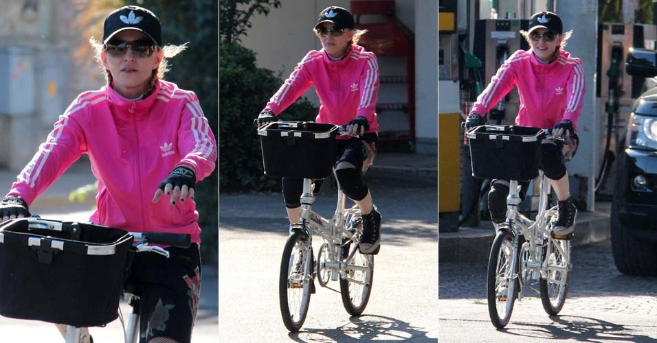 """Madonna aproveita passagem por Milão com a turnê de """"MDNA"""" para dar uma volta de bicicleta pelas ruas de Florença (16/6/12). Vestida com bermuda, lubas e boné, a diva pop se prepara para o último show italiano neste sábado (16). A turnê segue para Barcelona nos dias 20 e 21 de junho"""