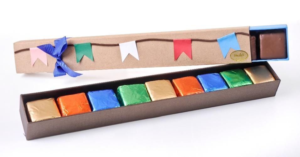 Caixa com a temática bandeirinhas juninas, da Tchocolat (www.tchocolath.com.br), possui nove pães de mel