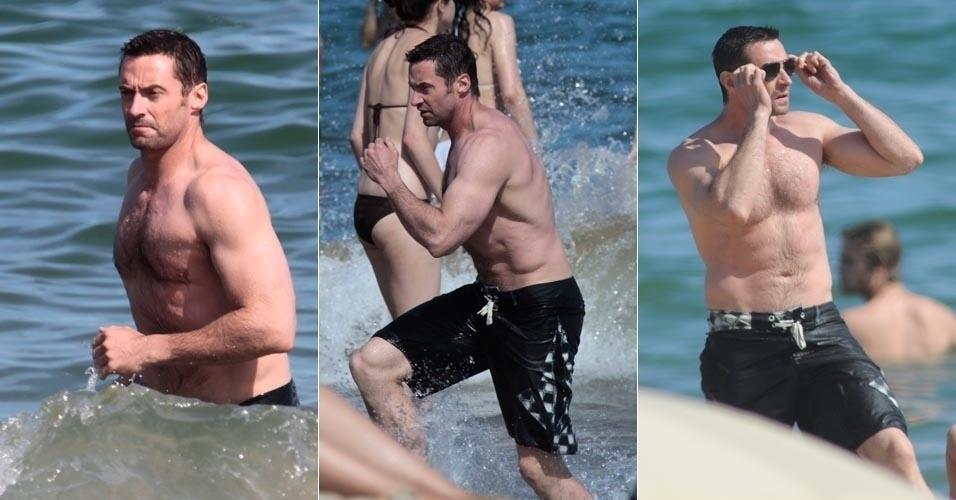 Hugh Jackman deixa músculos à mostra durante banho de mar em Barcelona (20/6/12)