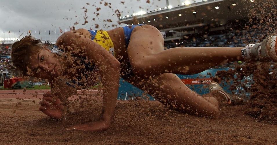 Atleta do salto em distância Marharyta Tverdohlib em ação no Campeonato Europeu de Atletismo, em Helsinque