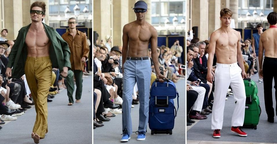 O estilista francês Pierre Cardin colocou modelos sem camisa na passarela para apresentar sua nova coleção. Calças menos ajustadas nas pernas e de tecidos leves são a aposta da grife para o Verão 2013 (1/7/2012)