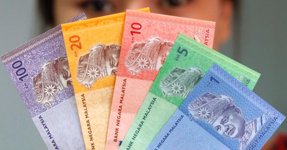 17.jul.2012 - Novas notas são apresentadas em Kuala Lumpur, na Malásia, nesta terça-feira (17)