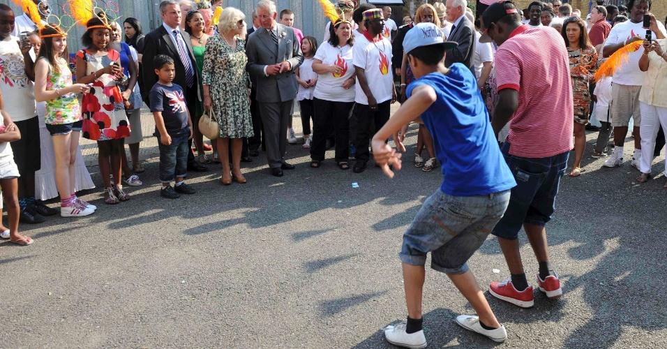 Príncipe Charles e Duquesa Camilla em apresentação comunitária em Tottenham, norte de Londres (25/07/2012)