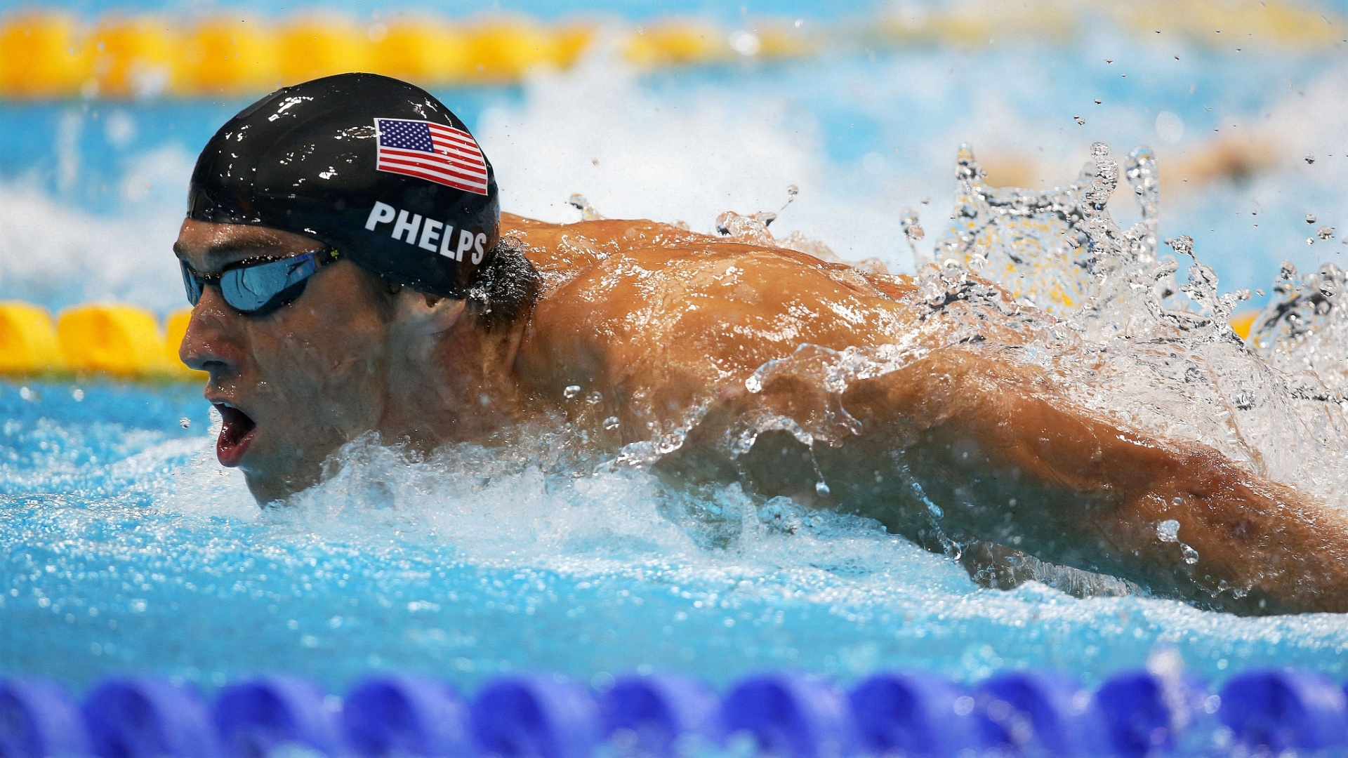 Norte-americano Michael Phelps nada para vencer a segunda semifinal dos 200 m borboleta (30/07/2012)