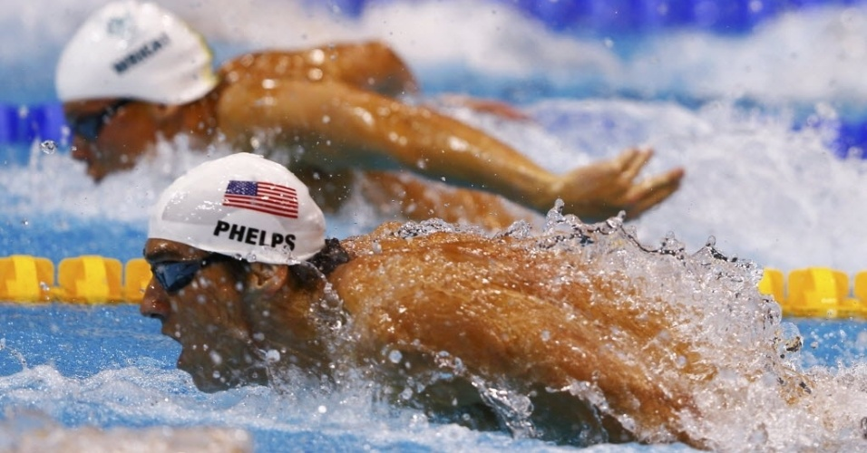 Michael Phelps disputa as eliminatrias dos 100 m borboleta
