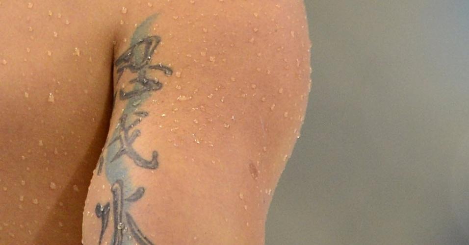 Nadador Thiago Pereira exibe tatuagem no braço direito após eliminatória dos 200 m medley individual