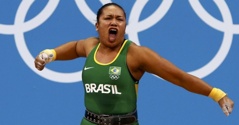 Brasileira Jaqueline Ferreira comemora ap&#243;s quebrar recorde brasileiro de levantamento de peso, em Londres (03/08/2012)