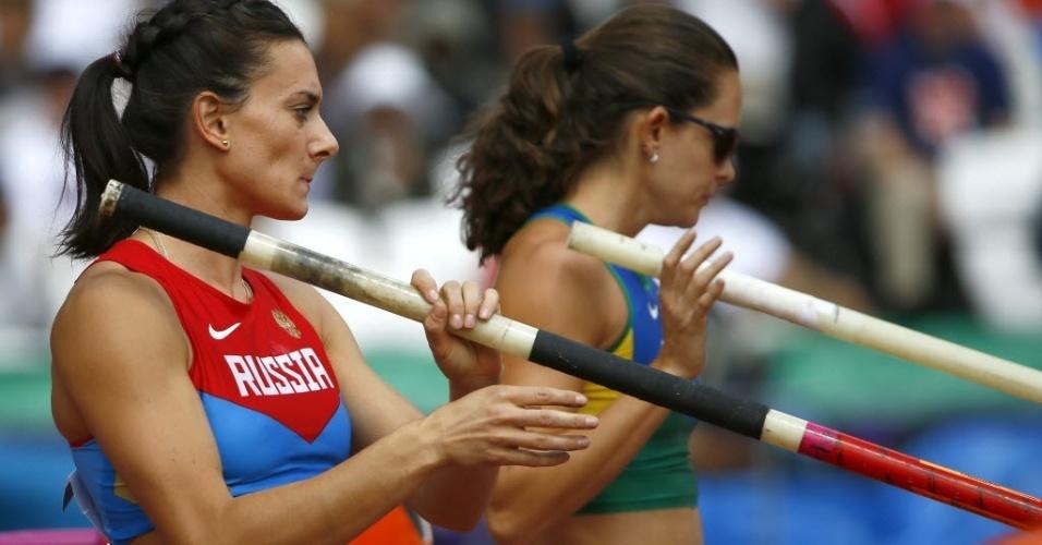 Yelena Isinbayeva e Fabiana Murer se concentram nas eliminatórias do salto com vara