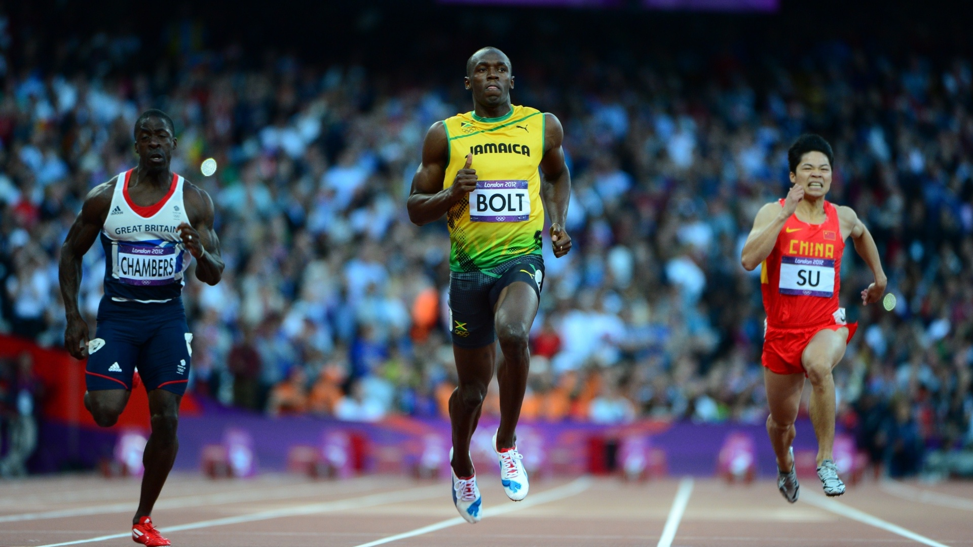 Jamaicano Usain Bolt (c) disputa a semifinal dos 100 m rasos entre o britnico Dwain Chambers (e) e o chins Su Bingtian