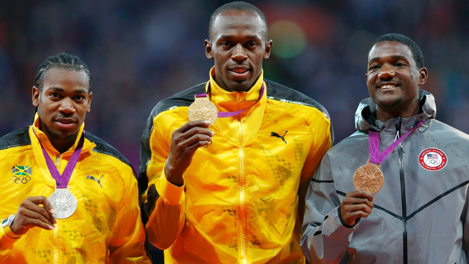 Da esquerda para direita, Yohan Blake, Usain Bolt e Justin Gatlin exibem medalhas conquistas na prova dos 100 m rasos