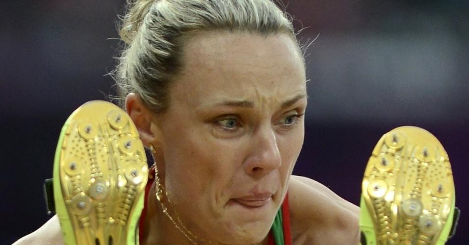 Veronika Shutkova , da Bielorússia durante eliminatória do salto em distância no Estádio Olímpico de Londres