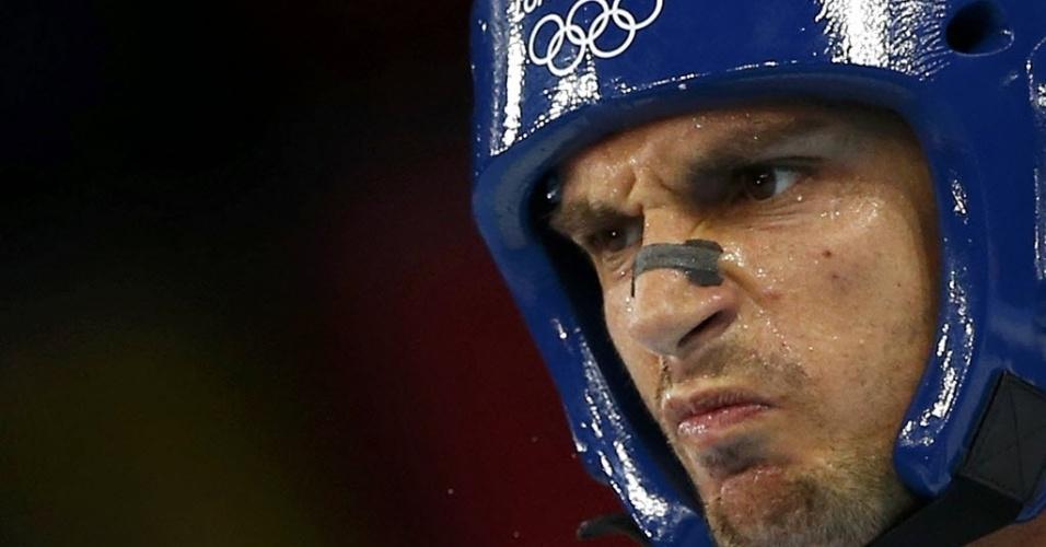 Italiano Carlo Molfetta faz cara de mau durante a disputa da categoria acima de 80 kg no taekwondo