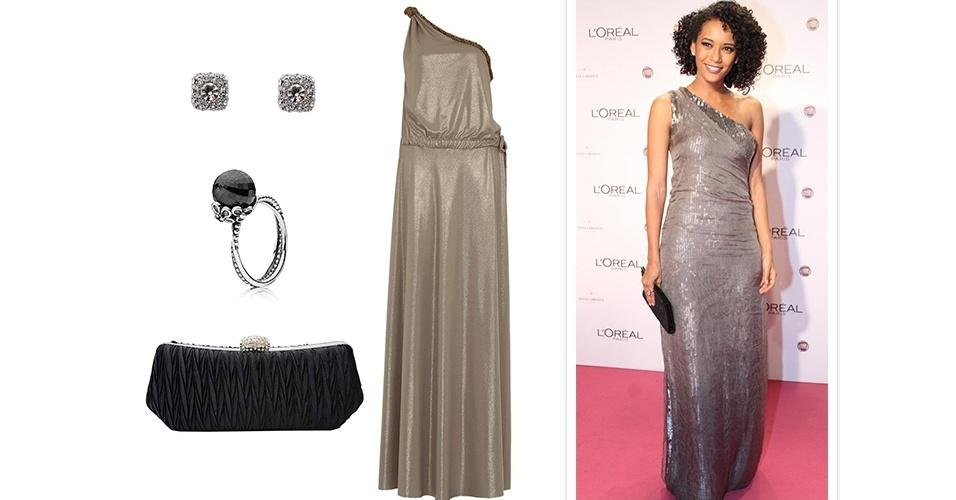 Brilho e modelagens simples fazem o estilo de Taís Araújo ao se vestir para eventos de gala. O vestido prata de ombro único foi usado com joias discretas e clutch preta