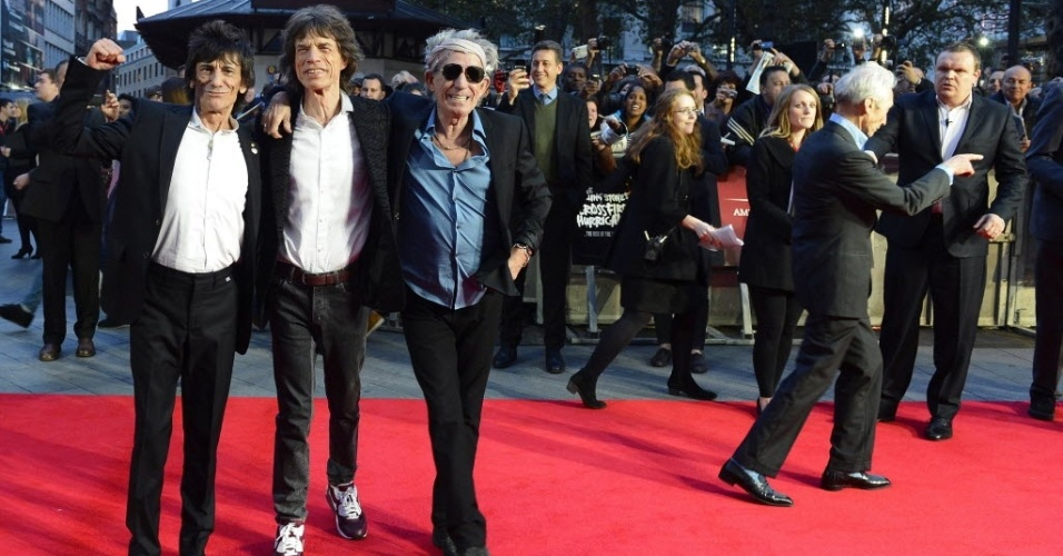 Charlie Watts, Ronnie Wood, Keith Richards e Mick Jagger, do Rolling Stones, causam alvoroo na chegada para o lanamento do documentrio 