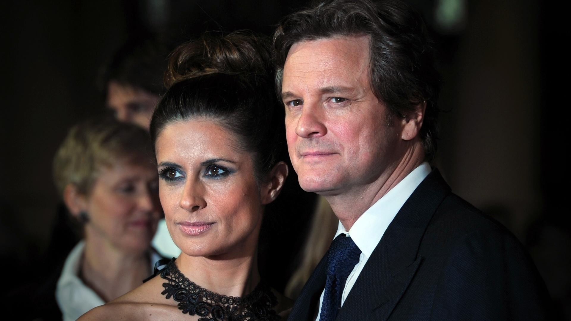 O ator inglês Colin Firth e a mulher Livia Giuggioli participam de evento em Londres (18/10/12)