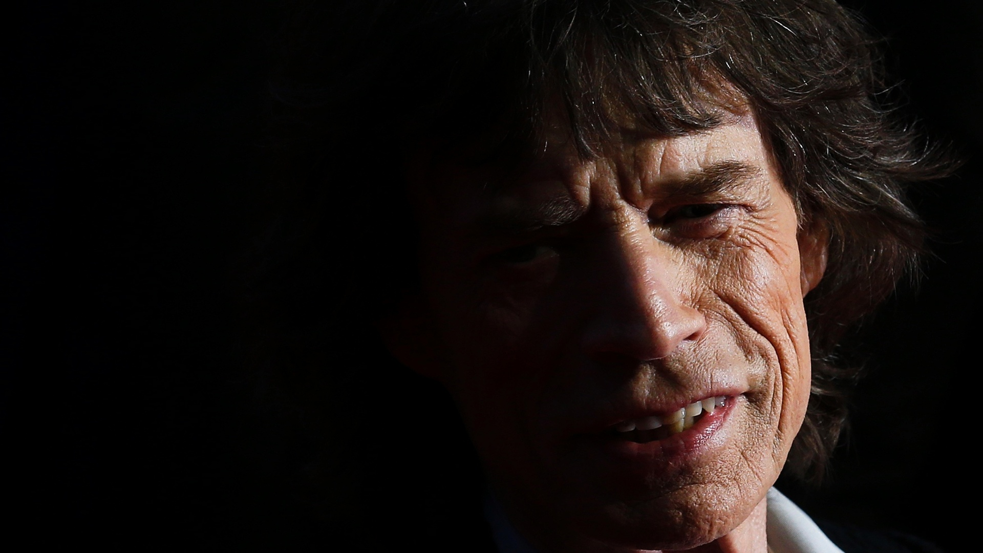 Vocalista dos Rolling Stones participa da premire de 