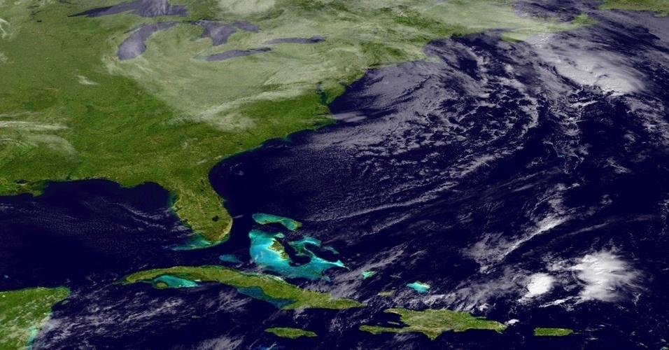 1.nov.2012 - A imagem, obtida pelo satélite NOAA, mostra a passagem da tempestade Sandy pelos Estados Unidos. Nova Jersey e Nova York estão entre os quatro Estados americanos mais atingidos pela tragédia. Os demais são Connecticut e Virgínia Ocidental. Pelo menos 54 pessoas morreram nos EUA em decorrência da passagem a tempestade