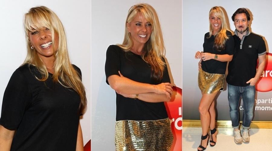 Adriane Galisteu exibiu o novo visual - franja e cabelos mais loiros - durante um evento patrocinado por uma operadora de telefonia em São Paulo (8/11/12). Ela estava acompanhada do marido, Alexandre Iódice