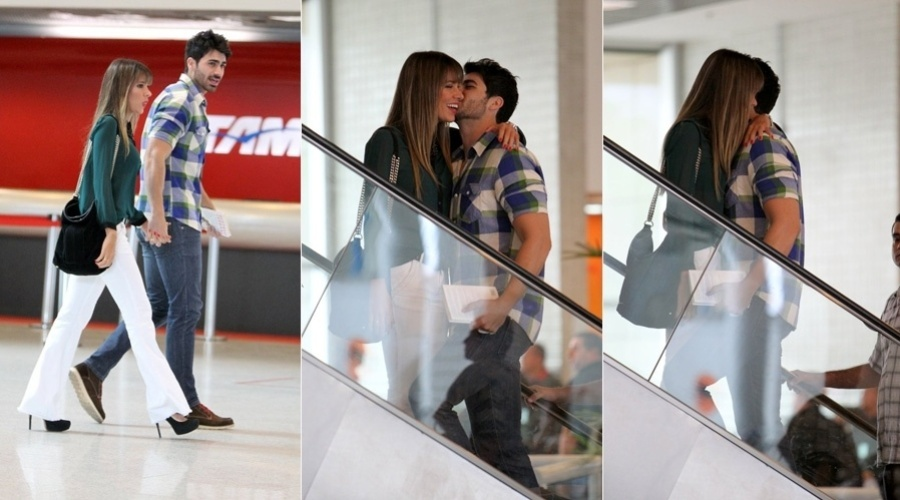 Os ex-BBB's Adriana e Rodrigo circularam nesta quarta-feira por um aeroporto do Rio (14/11/12). O casal trocou carícias