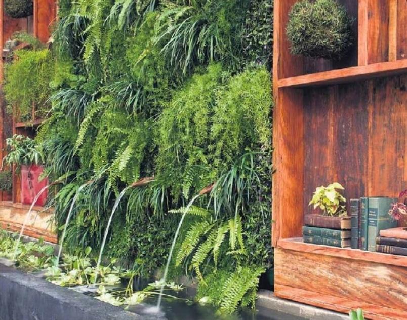 mini jardim de parede:Nesse ambiente criado por Gigi Botelho para uma mostra de decoração