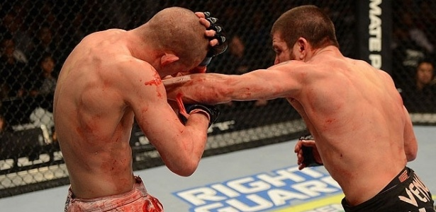 Joe Lauzon fica cheio de sangue at no calo ao ser derrotado por Jim Miller no UFC 155