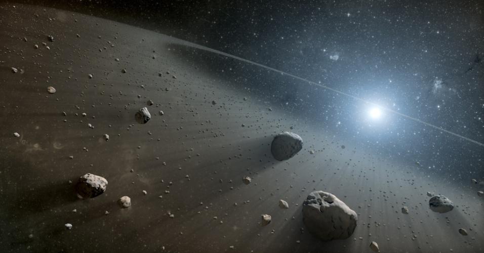 9.jan.2013 - Astrônomos descobriram o que parece ser um grande cinturão de asteroides (ilustração) em torno da estrela Vega, a segunda mais brilhante no céu noturno do hemisfério Norte. Segundo as observações feitas com os telescópios Spitzer, da Nasa (Agência Espacial Norte-Americana), e Herschel, da Agência Espacial Europeia (ESA, na sigla em inglês), o novo cinturão tem características semelhantes às dos conhecidos cinturões do nosso Sistema Solar: o de asteroides, que está localizado entre os planetas Marte e Júpiter, e o de Kuiper, que abriga muitos cometas na órbita de Netuno