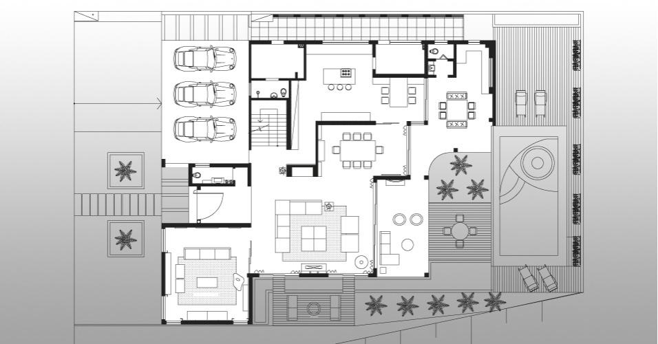 Planta mostra a disposição do pavimento térreo da casa em Barueri (SP), decorada por Giseli Koraicho. O piso reúne os ambientes de uso social como o living, varanda, cozinha e home theater