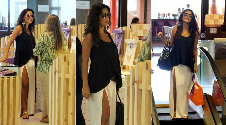 1.fev.2013 - Grávida de quatro meses, Juliana Paes passeou em um shopping da zona oeste do Rio. A atriz espera o segundo filho. Ela já é mãe de Pedro