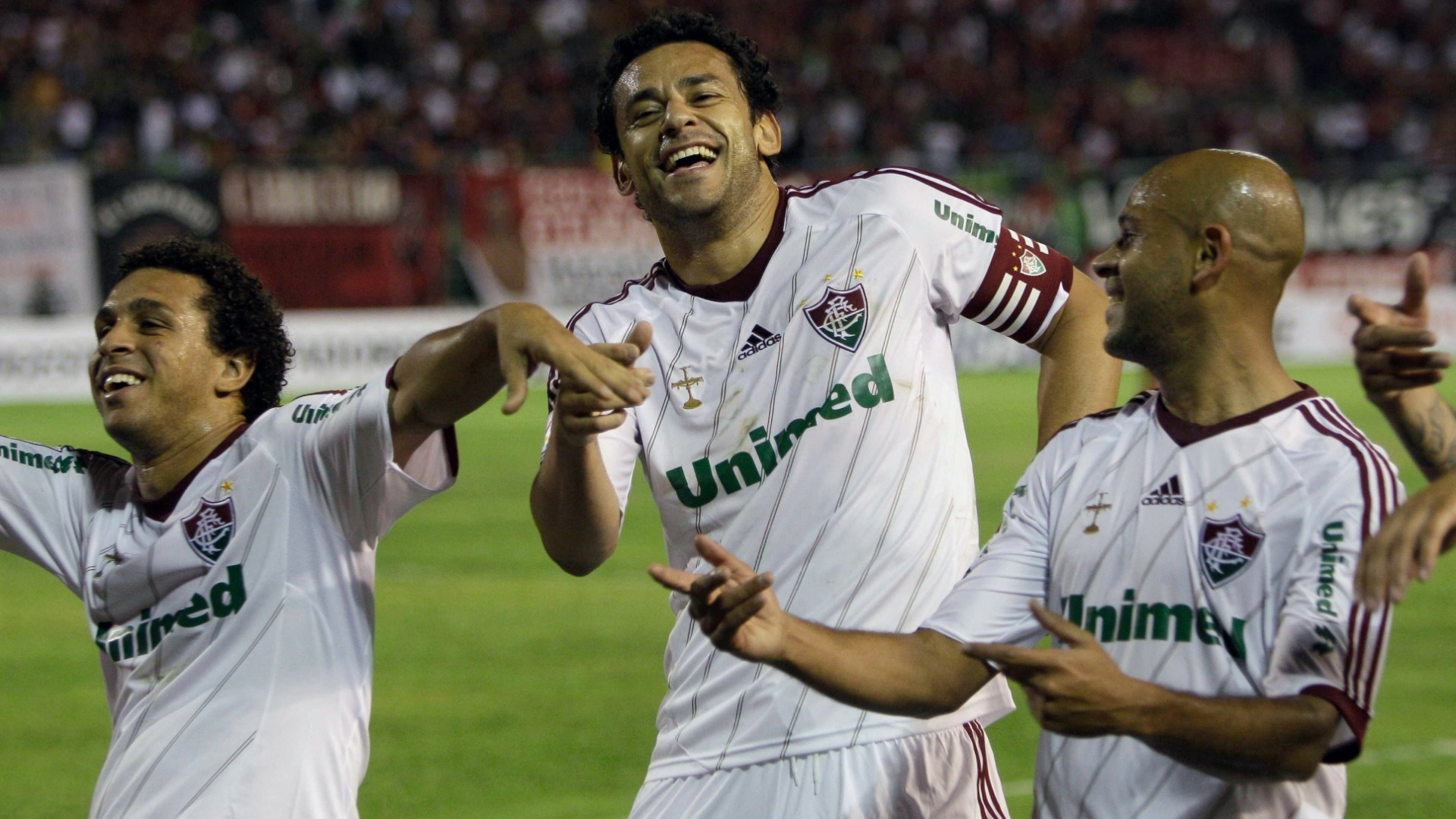13.fev.2013 - Jogadores do Fluminense comemoram o gol marcado por Fred contra o Caracas
