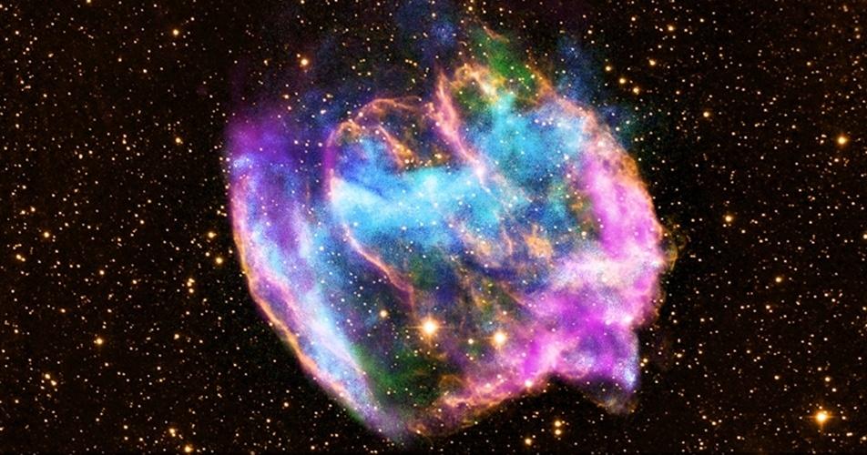 13.fev.2013- Rara explosão em supernova pode ter criado o buraco negro mais jovem da Via Láctea, segundo nova imagem do Observatório Chandra de raios-x da Nasa. A W49B é o que restou de uma explosão que ejetou matéria em grande velocidade nos polos de uma grande estrela giratória