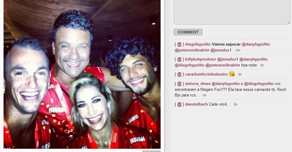 17.fev.2013 - Os irmãos ginastas Diego e Daniele Hypólito curtem o desfile das campeãs do Rio de Janeiro em camarote