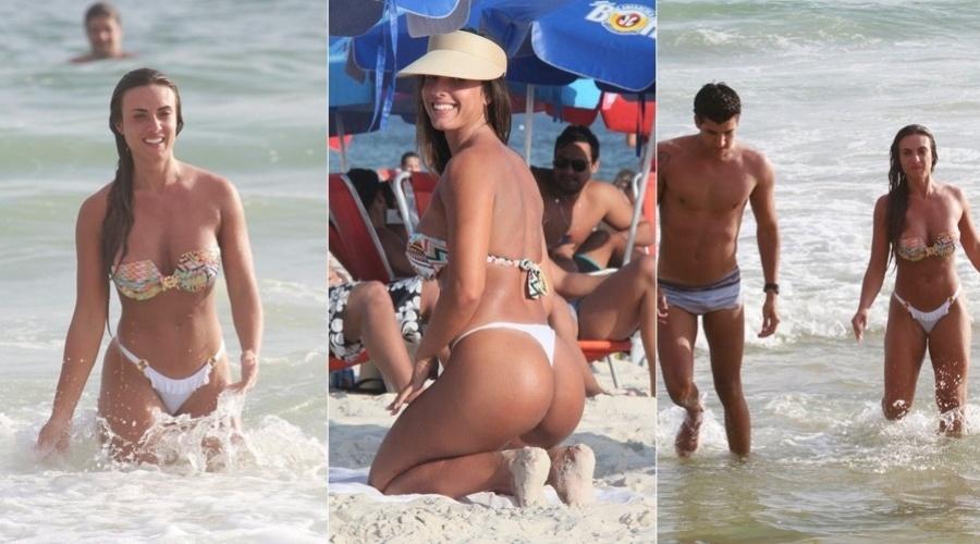 21.fev.2013 - Nicole Bahls curtiu praia na Barra da Tijuca, zona oeste do Rio. A modelo estava acompanhada do árbitro de futebol Diego Pombo