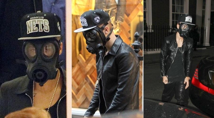 25.fev.2013 - Justin Bieber usou uma máscara de gás para se esconder dos paparazzi após passear em um shopping em Londres