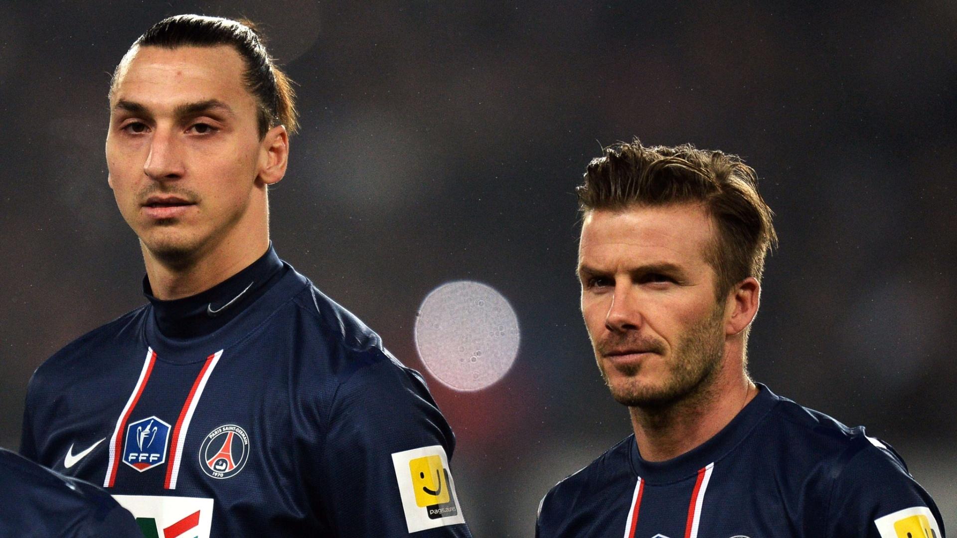 27.fev.2013 - Ibrahimovic e Bechham aguardam o início da partida entre PSG e Olympique de Marselha, pela Copa da França