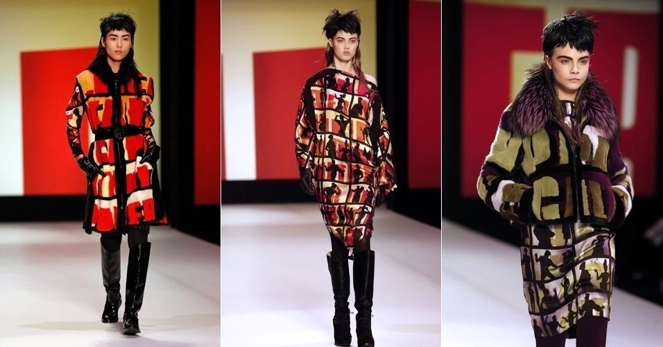 2.mar.2013 - Jean Paul Gaultier leva peças com estampas geométricas e botas envernizadas para as passarelas de Paris.