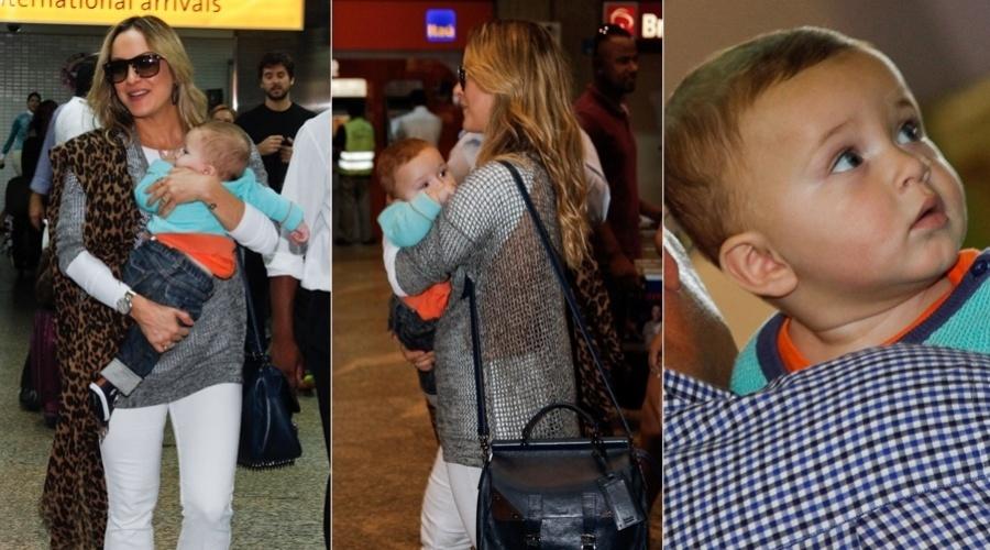 7.mar.2013 - Claudia Leitta desembarcou com a família no aeroporto de Guarulhos, em São Paulos, após viagem aos Estados Unidos. A cantora estava com o filho caçula, Rafael, no colo. Ela é mãe ainda de Davi